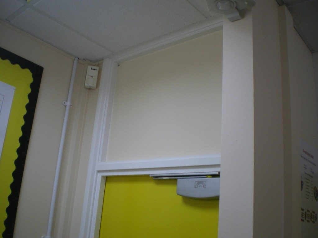 Asbestos Insulation Board above fire door